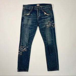 Medium wash jeans with floral embroidery